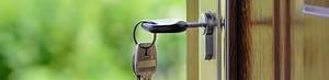 A key in the lock of an open door