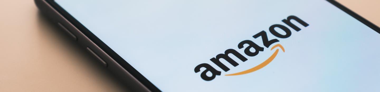 A phone screen showing the Amazon logo