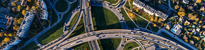 An overhead view of a series of busy highways running through a city
