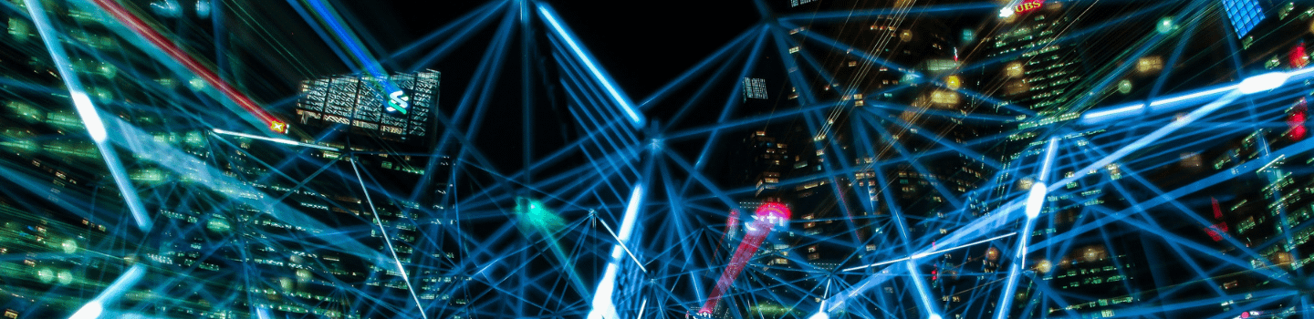 A neon blue web of interconnecting lines across a dark city sky